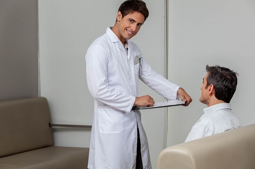 Patient and Eye Doctor Discuss the Merits of Undergoing LASIK Surgery