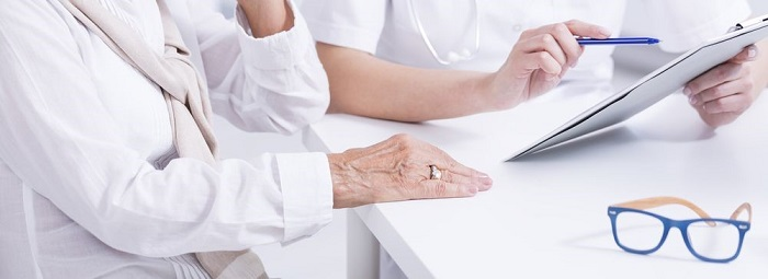 Patient Discuss Concerns During Appointment with Cataract Surgeons