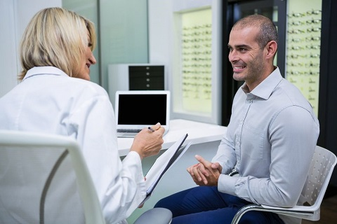 Patient Consults Surgeon Regarding the Upcoming Laser Eye Surger
